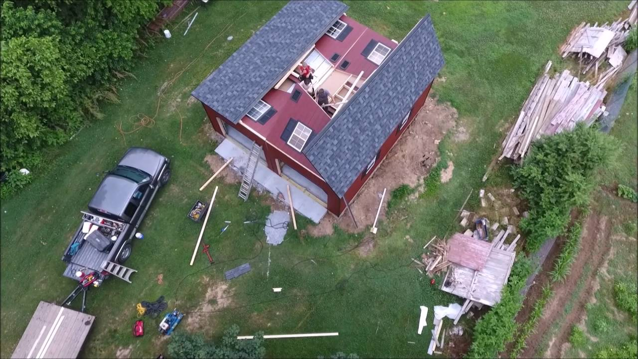 Aerial view of Amish 2 car garage/barn being delivered ...