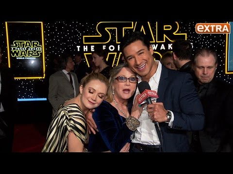 'Star Wars' Premiere: Carrie Fisher Cuddles & Serenades Mario Lopez on the Carpet
