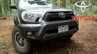 Toyota Tacoma aftermarket. 33-inch tires, off road