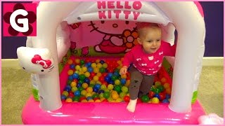 Gaby playing with Giant Hello Kitty Bouncy Castle