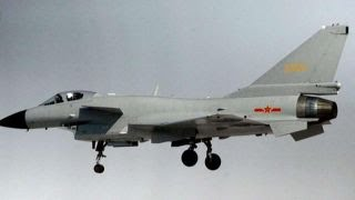 2 armed Chinese jets fly dangerously close to US spy plane