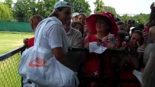Rafael Nadal signing autographs for his fans at Wimbledon