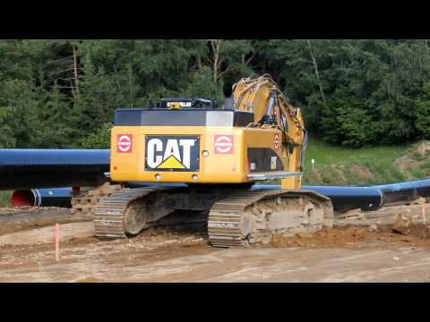 Caterpillar CAT 345D L digging a trench for a gas pipeline
