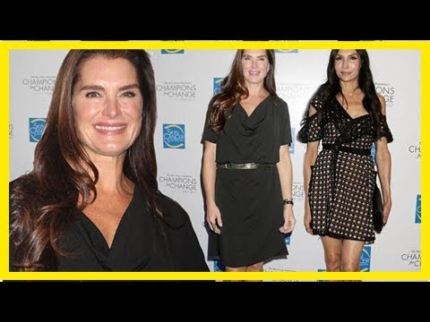 Back in black! brooke shields and famke janssen flaunt their legs in lbds at charity gala in nyc