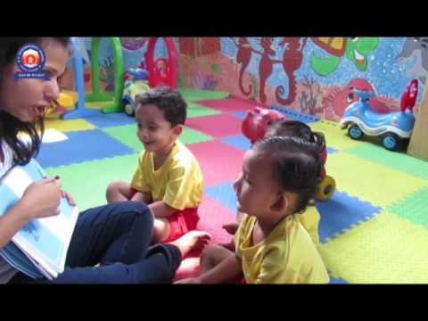 Students of Playgroup learning Alphabets