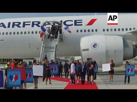World Cup winners arrive at Charles de Gaulle airport to heroes' welcome