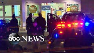 Suspect shot outside Louisville supermarket