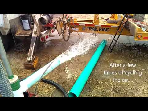Air lift cleaning a well