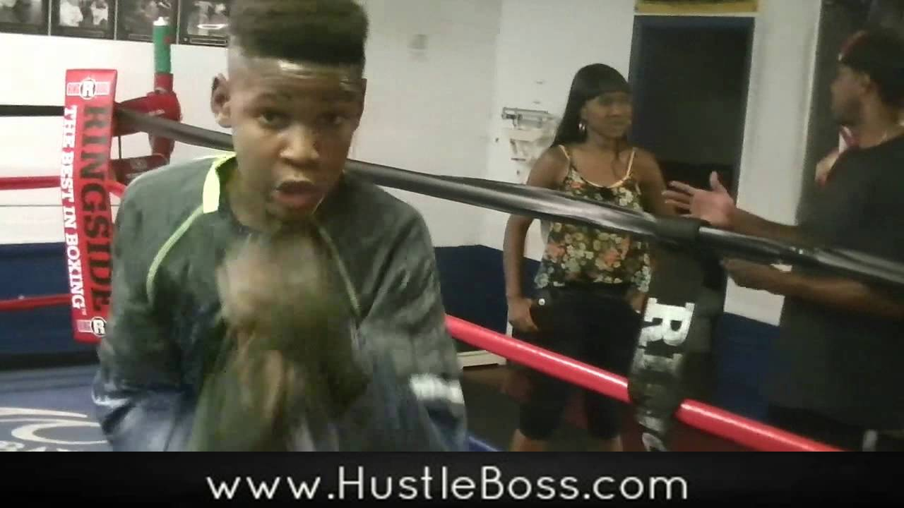 Former champion Arthur Williams works with 11-year old Ethan Smith at Johnny Tocco's
