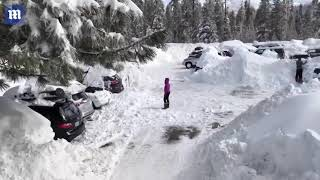 Heavy California snow is cleared after people trapped inside lodge