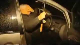 Funny: Iranian diplomat in London and his big umbrella