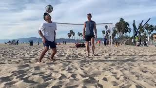 Two Friends Freestyling Soccer Tricks at the Beach - 1019699-2