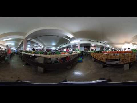 360 Video: Shoppers exploring a local produce market in Tonga