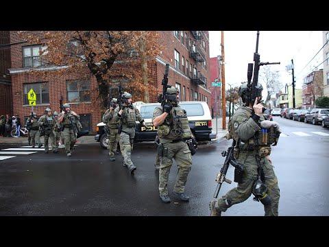 New Jersey gun battle leaves six dead including police officer