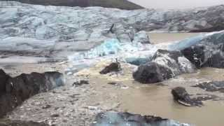 Iceberg Covered with Volcanic Ash Breaking Off from Svinafellsjokull Glacier in Iceland - AMAZING!