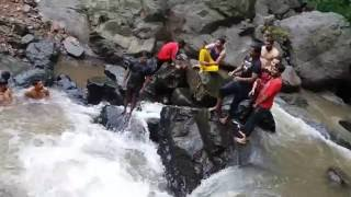 Arvind swimming - jumping off Waterfalls