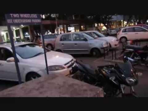 Bikers encroach in car parking
