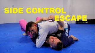 White Belt Escapes from Side Control When the Hip is Blocked