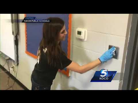 Teachers, faculty spend day cleaning Yukon elementary school after flu cancels classes