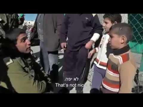 israel: ignorant israeli soldiers (IDF) harassing kids and activist woman
