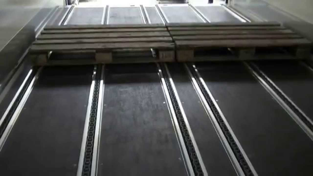 A-Service - Automatic loading and unloading chain system in truck trailer