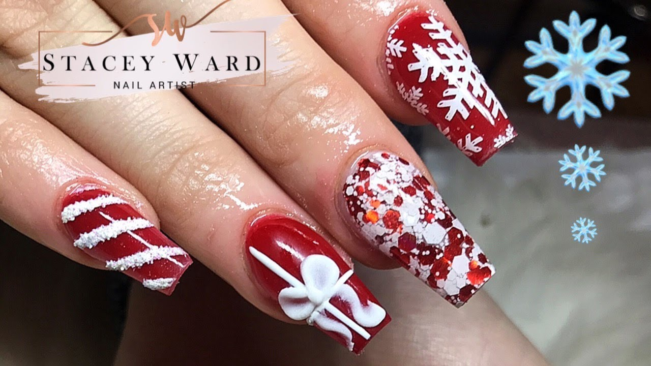 Red and white Christmas acrylic nails with stamping and 3D acrylic bow