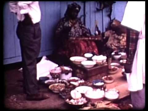 Tambwe at Kinshasa market: Hausa merchant, dryland West African materials. 1969.