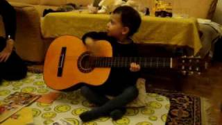 2.5-year-old guitar player