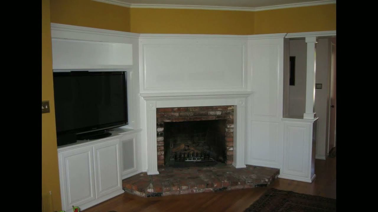 Built in white entertainment center cabinets and wall
