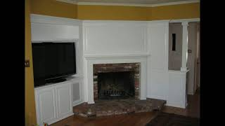 Built in white entertainment center cabinets and wall units