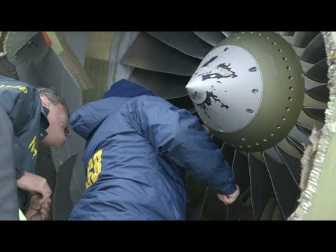 NTSB Investigators Examine Damaged Plane