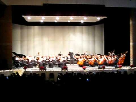piano student playing in orchestra
