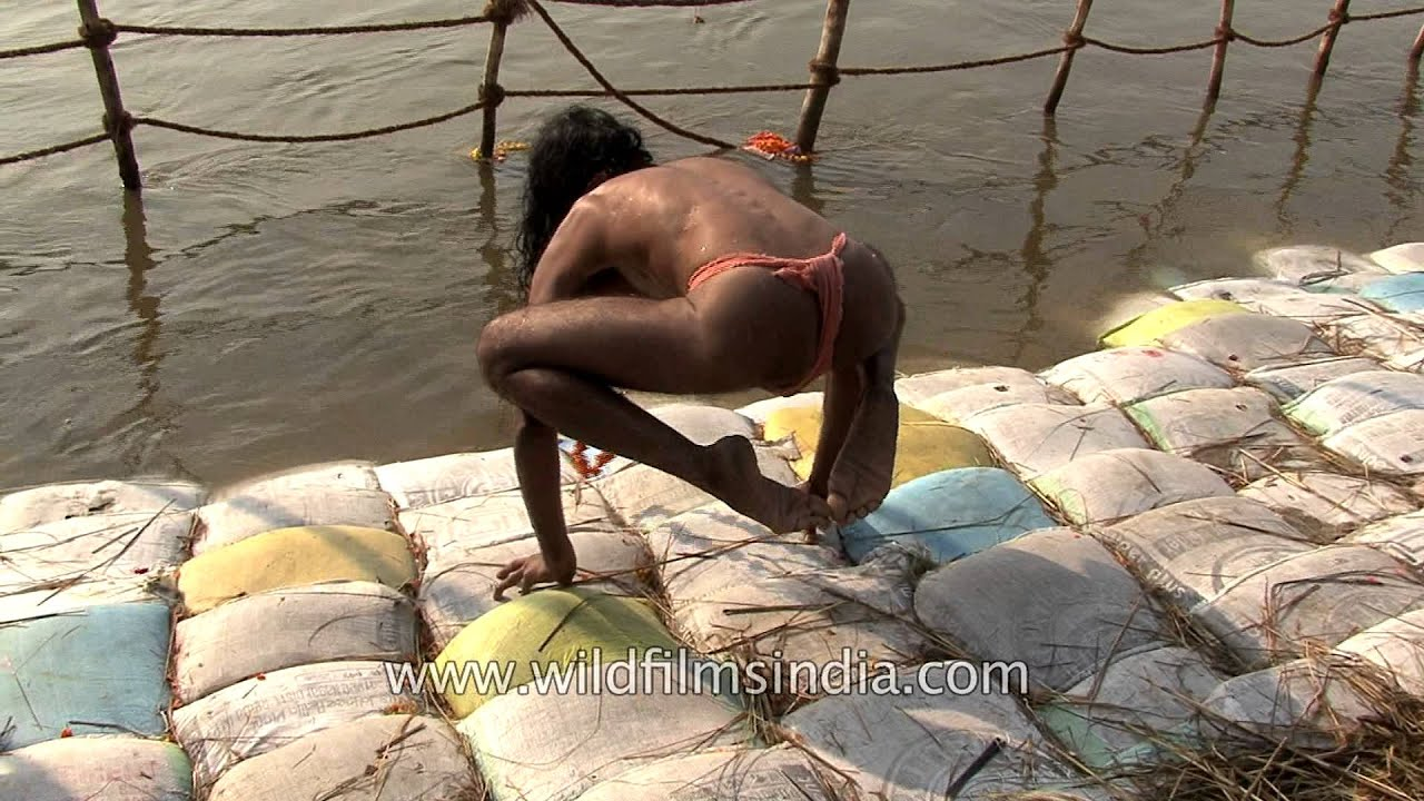 Only In India Sadhu Does Yoga On Sand Bags Ganges Bank Standing Fingers Alone