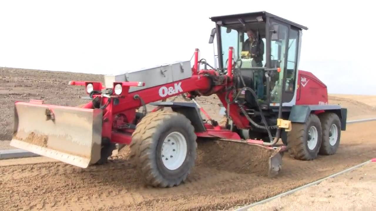 Volvo Wheeloader And O&K Grader TeamWork - YouTube