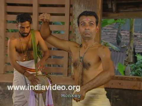 Performing the character of a monkey in Kutiyattam