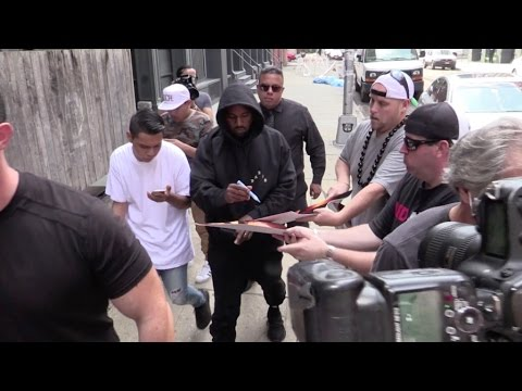 Kanye West sign autographs for his fans in New York City