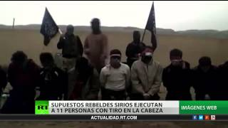 Repeat youtube video Video: Brutal ejecución de personas desarmadas por terroristas en Siria