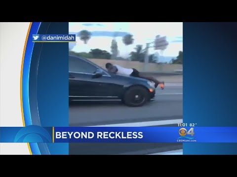 Video Captures Man Riding Hood Of Car On I-95