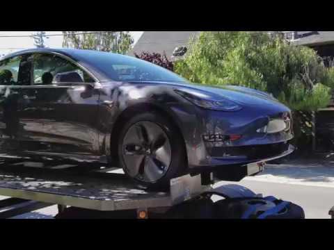 Tesla Model 3 Delivered to store