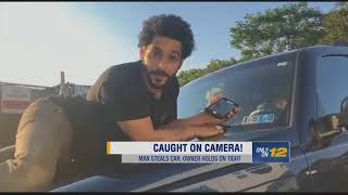 Accused Car Thief Takes Owner for Ride on Hood of SUV