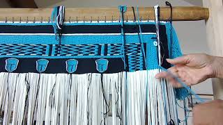 Weaving the side borders with both ravenstail and naaxiin (chilkat) techniques.