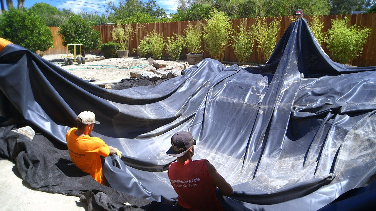 Koi pond construction pond liner installation part 25 for Fish pond installation