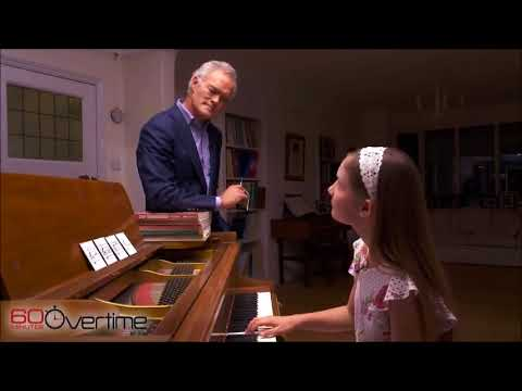 Watch a child prodigy create from four notes in a hat