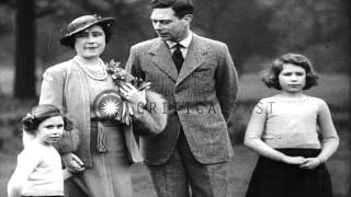 King George VI and Queen Elizabeth with their two daughters in London. HD Stock Footage