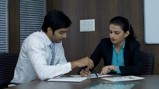 Young productive businessman and woman discussing a work plan - Conference room meeting