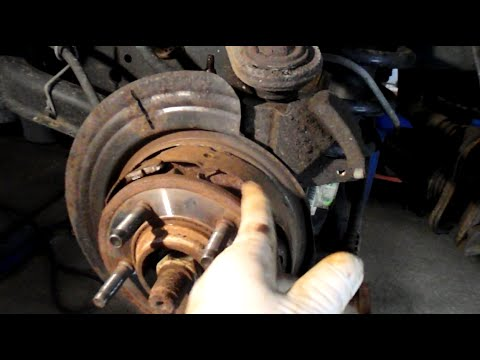 How to replace the parking brake shoes on a 2003 Ford