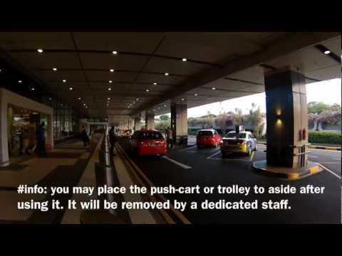 Where is Terminal 1 Taxi Stand in Singapore Changi Airport?