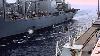 Supplies come over a hi-line to the USS Princeton for replenishment in Vietnam. HD Stock Footage