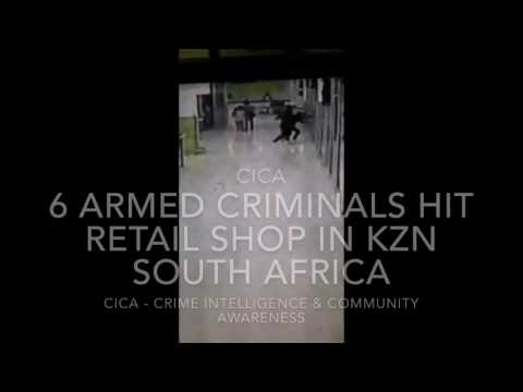 Armed criminals break into a Cash Crusaders shop in Durban KZN South Africa