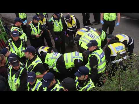 Police lift Protectors attached to lock on device at anti-fracking protest